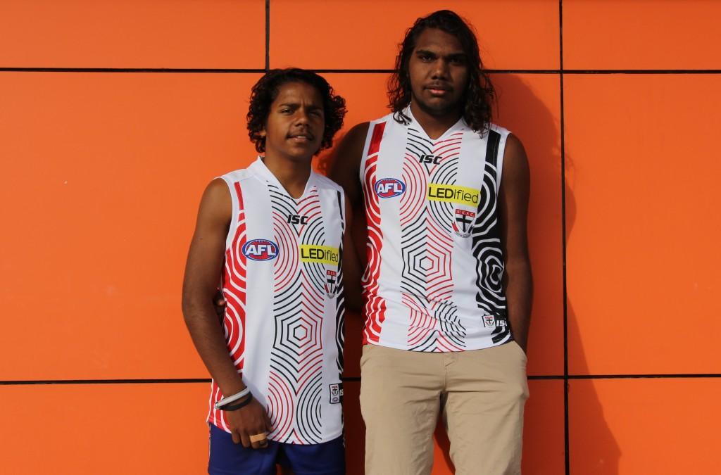 St Kilda City's indigenous stars Jesse Firebrace (left) and Kane Plummer model the Indigenous Round jumper.