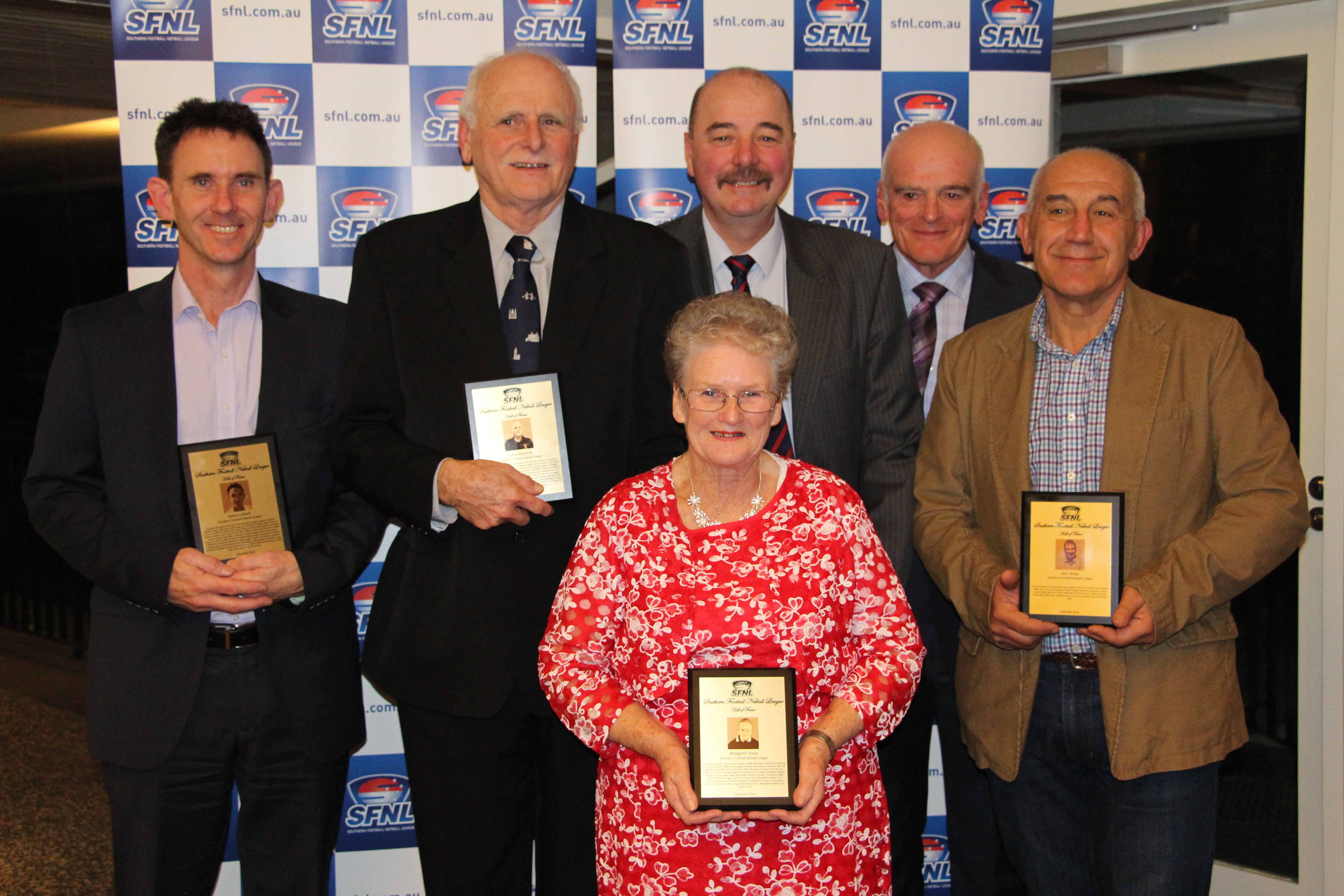 The 2016 SFNL Hall of Fame inductees pose with their plaques