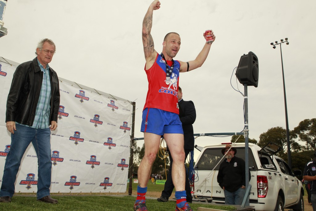 McAnulty collects his Meneilly Medal as best on grounf. CREDIT: Everard Fenton, Memento Sports.