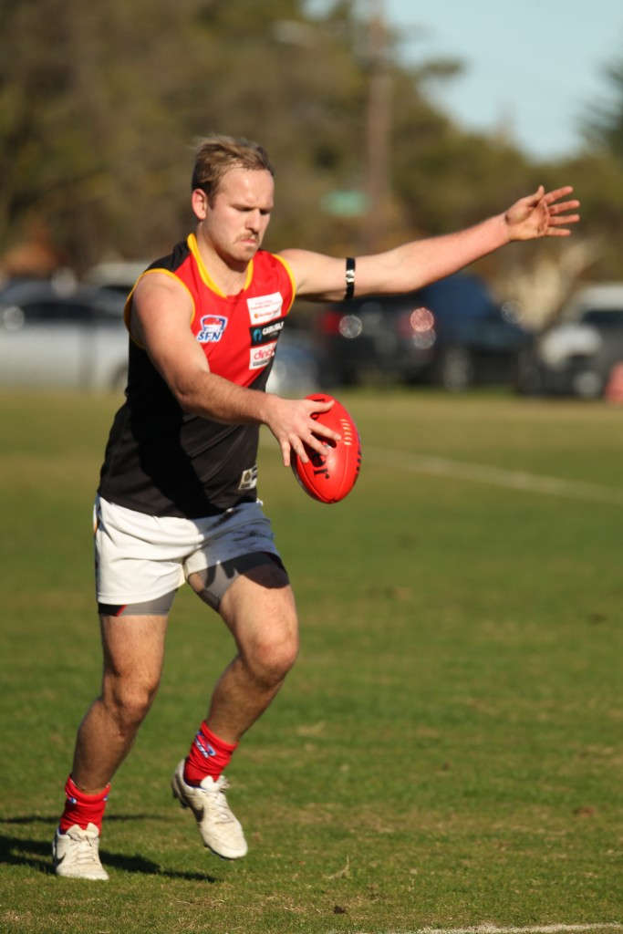 Dingoe Dan Farmer poses a serious threat both through the midfield and in attack.