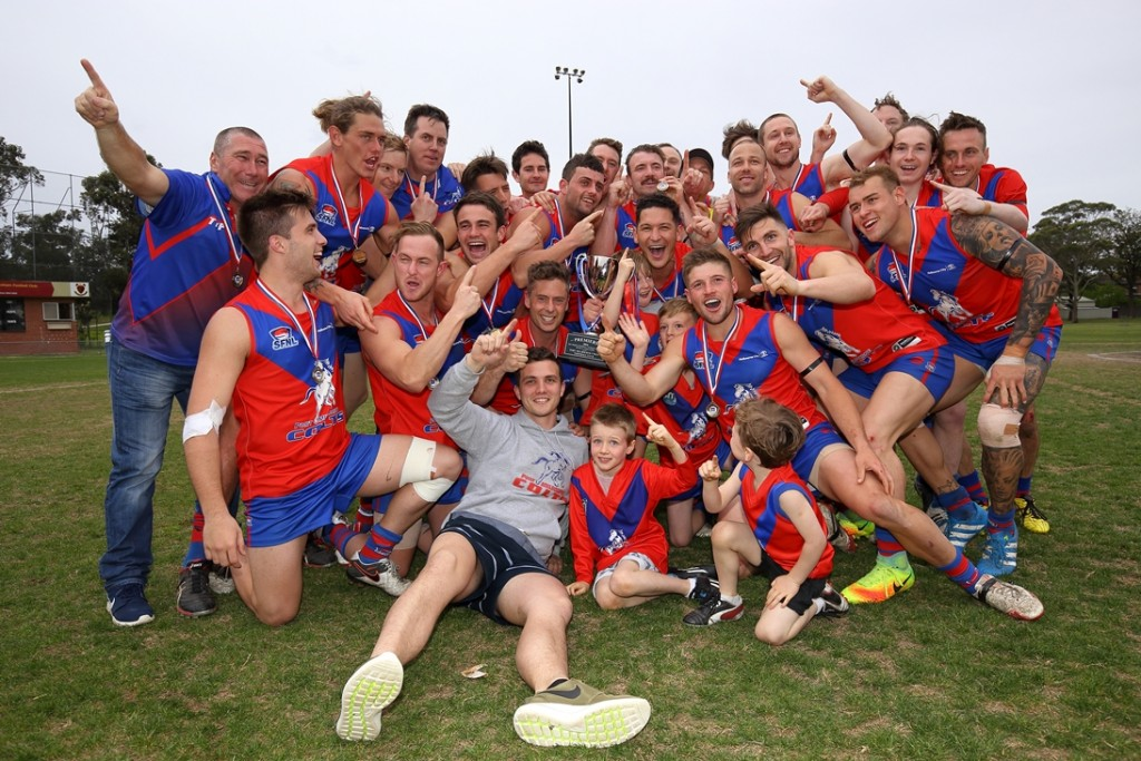 To the victors the spoils! The Colts celebrate the Senior and Reserve premierships. CREDIT: Julian Inglese, Photogenix