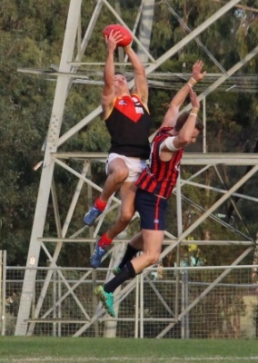 Dingo Robbie Rusan climbs high over Panther Ryan Mullett to reel in a screamer.