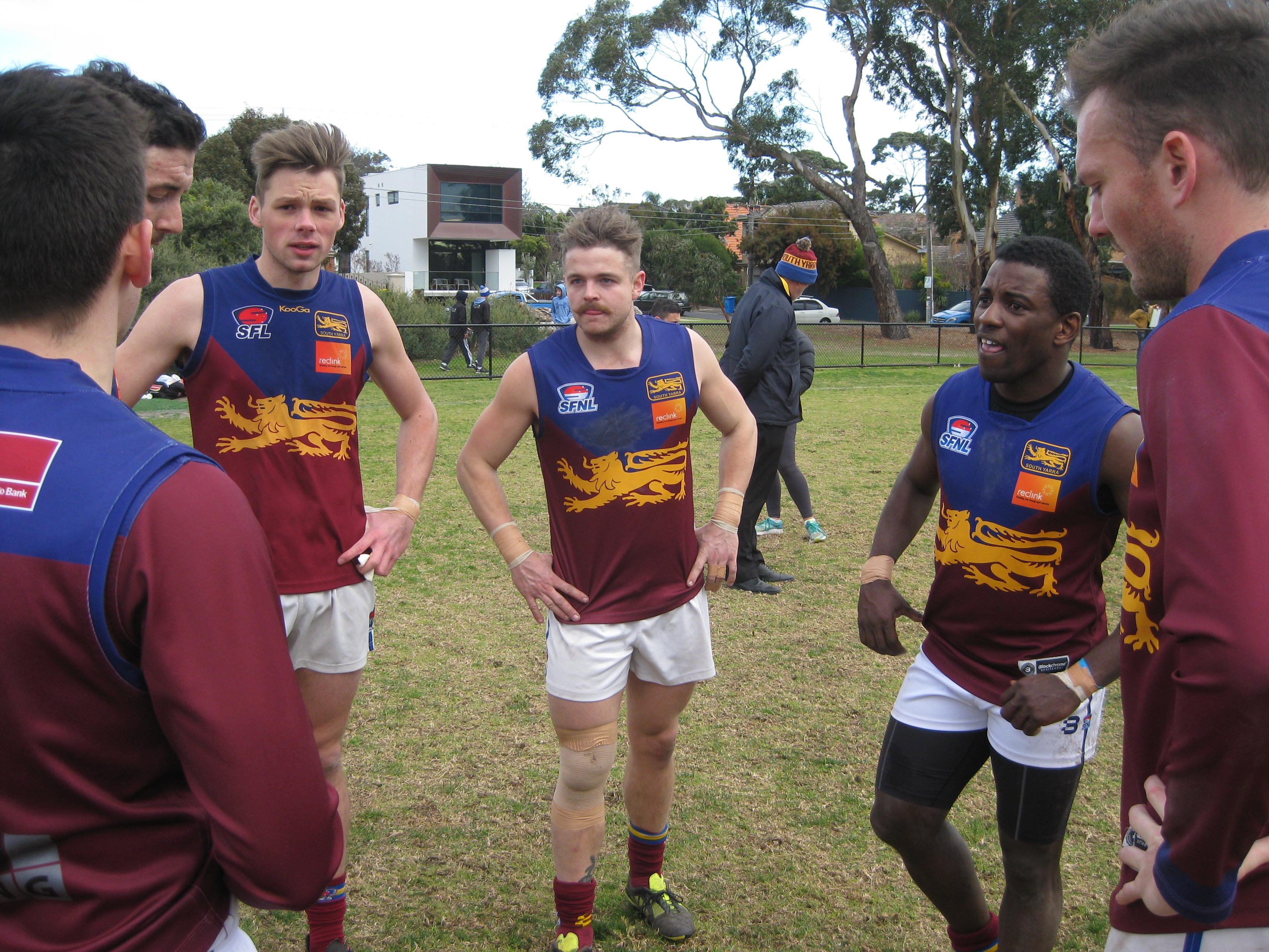 Mwaba (second from right) in the South Yarra huddle.